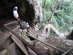 Our guide leads Ben down the steep staircase