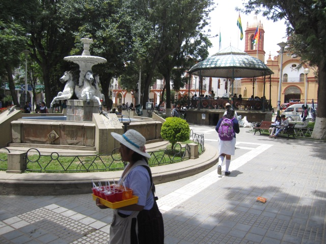 A woman selling jello cups in Sacaba's central plaza