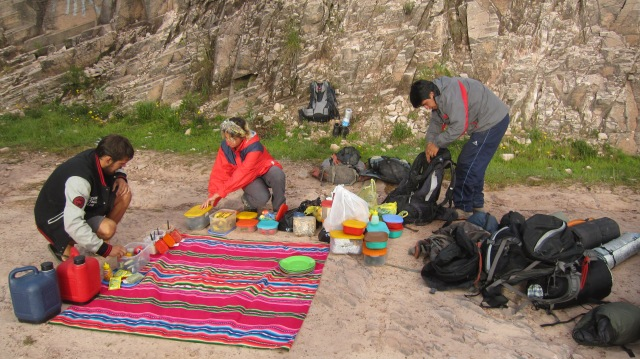 Our volunteer guides on the trek - Josh (Australia), a young british girl, and a Bolivian student studying at the University of Sucre – make the final checks on our 4-day supply of rations