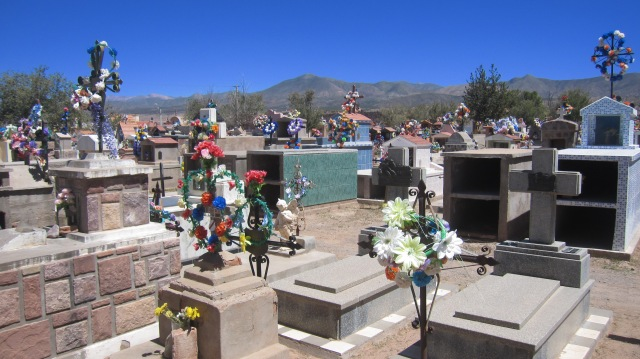The typical South Americann style cemetery -graves adorned with garlands of flowers -  in Humahuaca