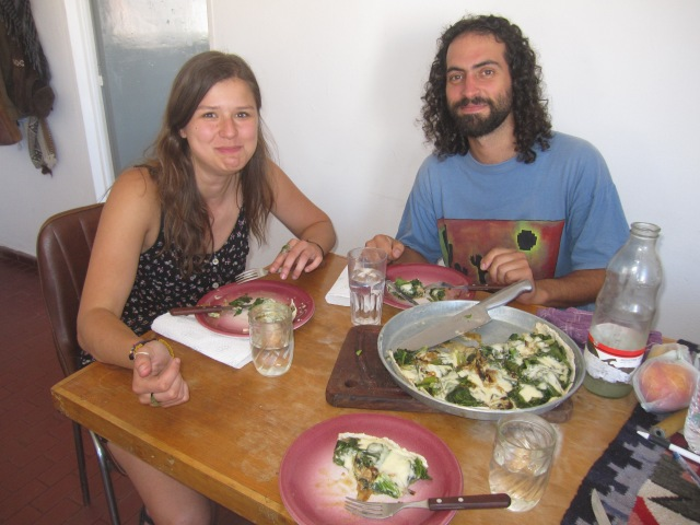 Jelena and José enjoy a tasty pizza-esque spinach pie prepared by José