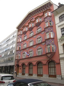 "The Cooperative Business Bank Building (the ""Pink Bank""), designed in traditional Slovenian styles by architect Ivan Vurnik and his wife Helena Vurnik.  The Pink Bank has been called the ""most beautiful building"" in Ljubljana."