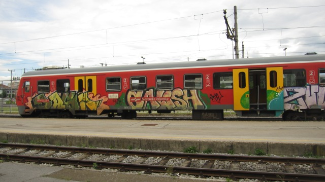 A colorful train in Ljubljana's train station